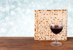 Passover background. wine and matzoh (jewish passover bread)  over wooden background. glitter background. Stock Images