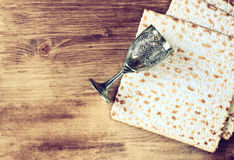 Passover background. wine and matzoh (jewish passover bread) over wooden background. Vintage effect process Stock Images