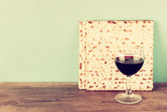 Passover background. wine and matzoh (jewish passover bread)  over wooden background. Vintage effect process Royalty Free Stock Image