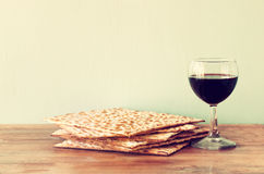 Passover background. wine and matzoh (jewish passover bread)  over wooden background. Stock Images