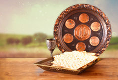 Passover background. wine and matzoh (jewish passover bread) on wooden table Stock Photos