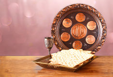 Passover background. wine and matzoh (jewish passover bread) on wooden table Stock Images