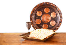 Passover background. wine and matzoh (jewish passover bread) on wooden table Stock Photo