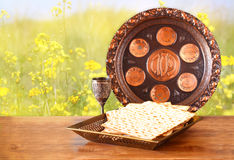 Passover background. wine and matzoh (jewish passover bread) on wooden table Royalty Free Stock Photo