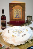 Passover Dinner Celebrations. Table prepared with blessings, red grape jucie and the religious text (haggadah) for the Jewish holiday of Passover Royalty Free Stock Photo