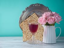 Passover holiday celebration concept. With wine, matzo, flowers and seder plate Stock Image