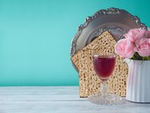 Passover holiday celebration concept. With wine, matzo, flowers and seder plate Royalty Free Stock Image