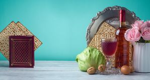 Passover holiday celebration concept. With wine, matzo and seder plate Royalty Free Stock Photo
