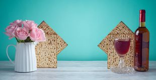 Passover holiday celebration concept. With wine, matzo and flowers Stock Images