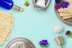 Passover holiday concept with wine bottle and matzoh over mint background with copy space. Top view. From above Stock Photography