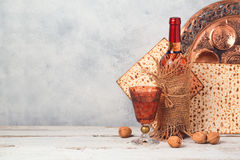 Passover holiday concept with wine and matzoh over rustic background Stock Images