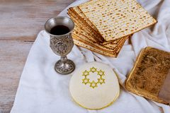 Passover holiday concept with wine and matzoh rustic background. Passover holiday concept with wine and matzoh over rustic background Stock Image