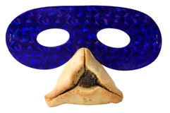 Passover Items. Hamantashen, traditional pastry and a party mask for the Jewish holiday of Purim Royalty Free Stock Image