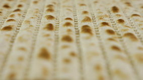 Passover matzah traditional jewish holiday bread. Passover or Pesach matzah is a traditional jewish holiday bread for passover. Pesach celebration symbol stock video footage