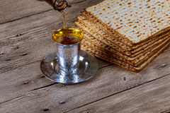 Passover matzo with kiddush cup of wine wooden table Royalty Free Stock Photo