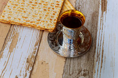 Passover matzo with kiddush cup wine on wooden table. Jewish holiday, Holiday symbol passover matzo with kiddush cup of wine on wooden table Stock Photo