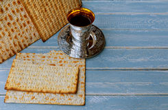 Passover matzo with kiddush cup of wine wooden table. Jewish holiday, Holiday symbol passover matzo with kiddush cup of wine on wooden table Royalty Free Stock Image