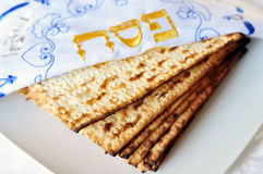 Passover or Pesach word in Hebrew with Matzo for Jewish Holiday Royalty Free Stock Photography