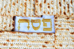 Passover or Pesach word in Hebrew with Matzo for Jewish Holiday Stock Photo