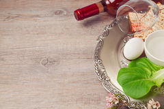 Passover (pesah) background with seder plate, matzoh and wine over wooden background Stock Images