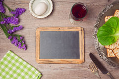 Passover (pesah) holiday celebration with chalkboard and seder plate. View from above Royalty Free Stock Image