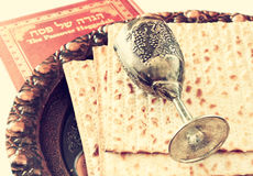 Passover plate wine cup and matzoh. Passover background. passover plate wine cup and matzoh (jewish passover bread) over wooden background Stock Photo