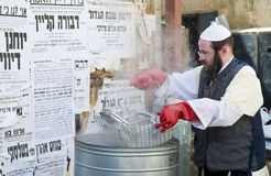 Passover preparation. JERUSALEM - APRIL 05 : An Ultra Orthodox man is preparing to the Jewish holiday of Passover by purifacation of the dishes in Jerusalem Royalty Free Stock Image