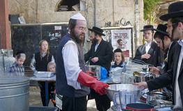 Passover preparation. JERUSALEM - APRIL 05 : An Ultra Orthodox Jews are preparing to the Jewish holiday of Passover by purifacation of the dishes in Jerusalem Royalty Free Stock Images
