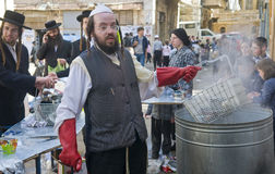 Passover preparation. JERUSALEM - APRIL 05 : An Ultra Orthodox Jews are preparing to the Jewish holiday of Passover by purifacation of the dishes in Jerusalem stock photos