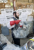 Passover preparation. JERUSALEM - APRIL 05 : An Ultra Orthodox man is preparing to the Jewish holiday of Passover by purifacation of the dishes in Jerusalem royalty free stock photo