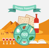Passover seder plate with flat trasitional icons over a desert background Royalty Free Stock Images