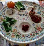 Passover Seder Plate. Jewish Holidays: Traditional Seder Plate on Passover Table Stock Photos