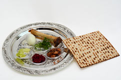 Passover Seder Plate. Matzo bread next to Passover Seder Plate with The seventh symbolic item used during the seder meal on passover Jewish holiday. White Stock Images