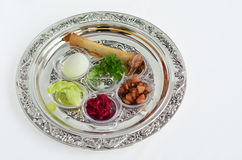Passover Seder Plate. With The seventh symbolic item used during the seder meal on passover Jewish holiday. White background with copy space Royalty Free Stock Photography