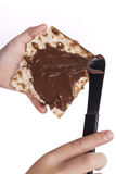 Passover Sweet. Child hand Macking Chocolate With Matzah for Passover Stock Images