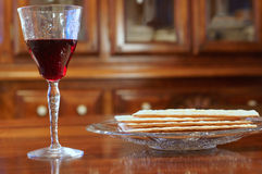 Passover wine and matzoh. On a table at eye level Royalty Free Stock Photos