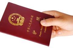 Passport. A hand hold a passport of China Stock Photo