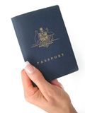 Passport. Hand over your passport- on a white background Stock Photos