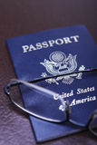 Passport. A United States of America Passport with a pair of glasses Stock Photography