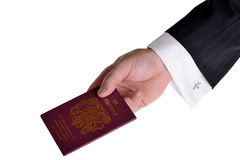 Passport. Buisness man presenting a passport isolated on white background Stock Photos