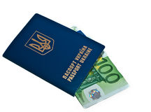 Passport. International Ukrainian passport with Euro banknotes isolated on background Stock Images