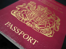 Passport. UK Passport in close-up against a dark background royalty free stock images