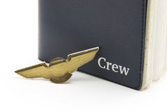 Passport. Small wing pin and airline crew member passport royalty free stock image