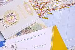 Passport and air ticket over map. Royalty Free Stock Photography