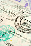 Passport background. Macro / selective focus image of passport stamps.  Focus is in the middle