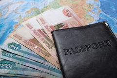 Passport in the bag on a map with bank notes Royalty Free Stock Images