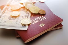 Passport with banknotes and coins on a plain background royalty free stock photos