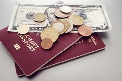 Passport with banknotes and coins on a simple background. business, tourism, travel concept stock image