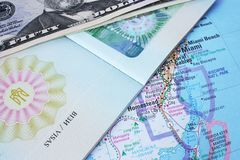 Passport and banknotes with map background Royalty Free Stock Photography