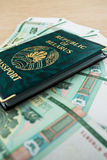 Passport of Belarus with rubles Stock Photo